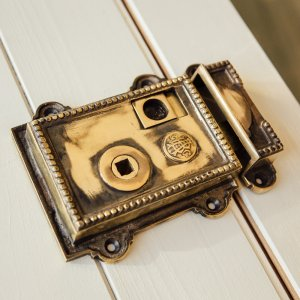 Beaded Regency-Style Rim Latch - Aged Brass
