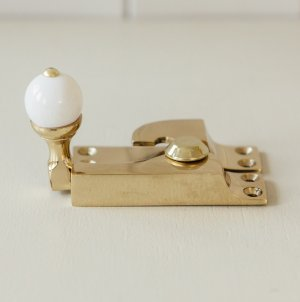Straight Arm Sash Window Fastener with White Knob - Brass