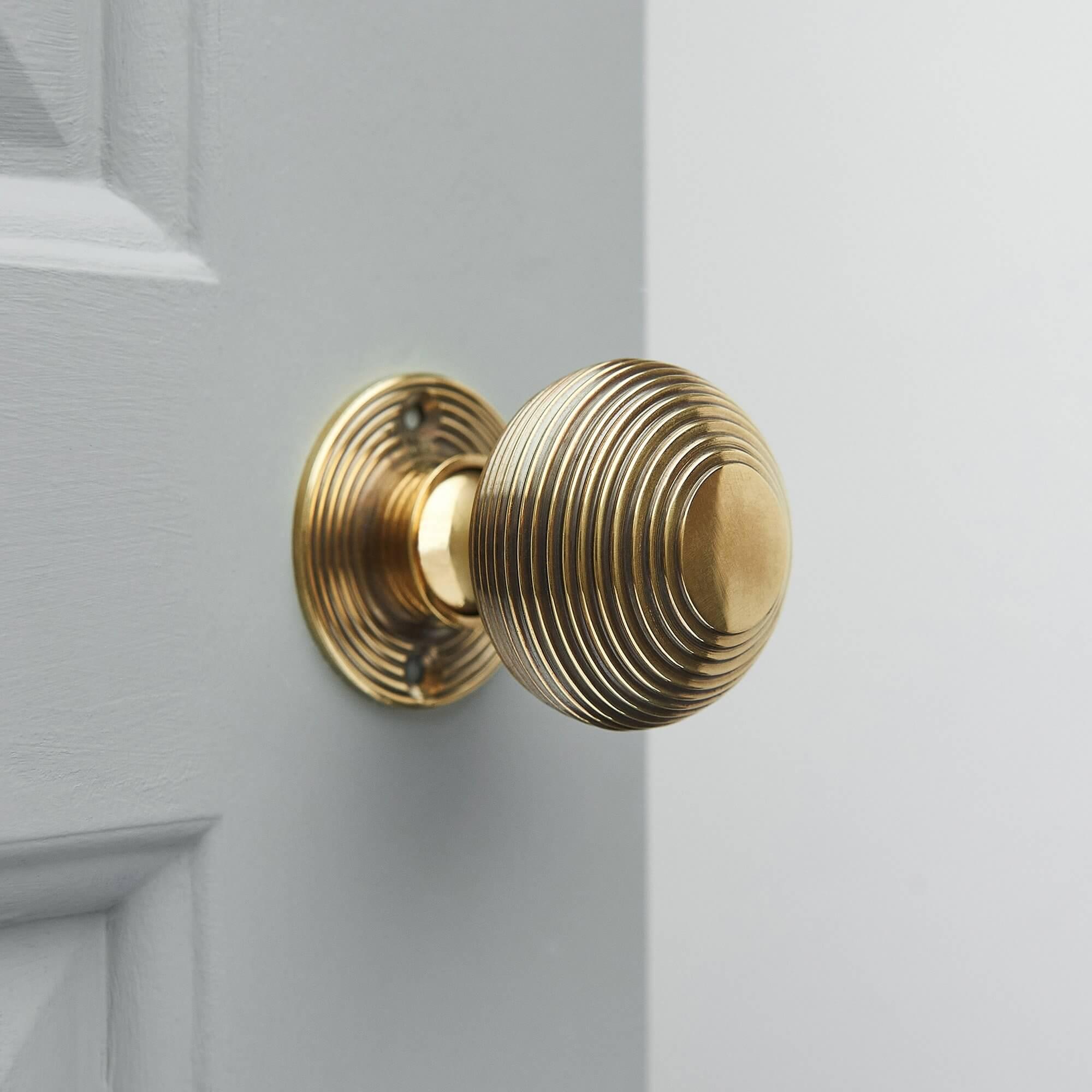 Beehive Mortice/Rim Door Knobs (Pair) - Aged Brass
