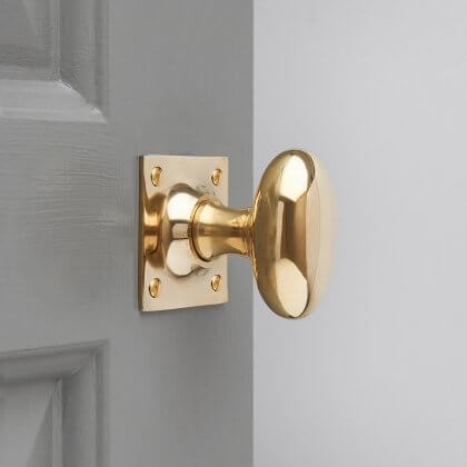 Oval Door Knobs on Square Back Plate (Pair) - Polished Brass