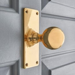 Round Door Knobs on Rectangular Backplate (Pair) - Polished Brass