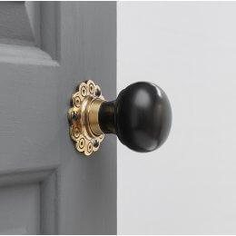 Ebony Bun Door Knobs (Pair) - Aged Brass Collar & Rose